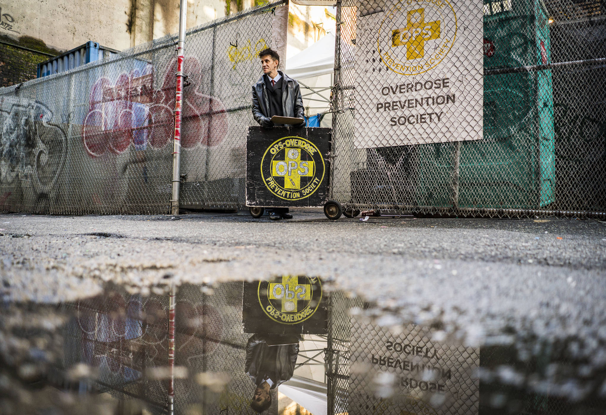 The Overdose Prevention Society runs one of Vancouver's safe-injection sites, an operation that started as a pop-up and now includes a permanent facility. Frederick Williams checks off users as they enter. Washington Post photo by John Lehmann
