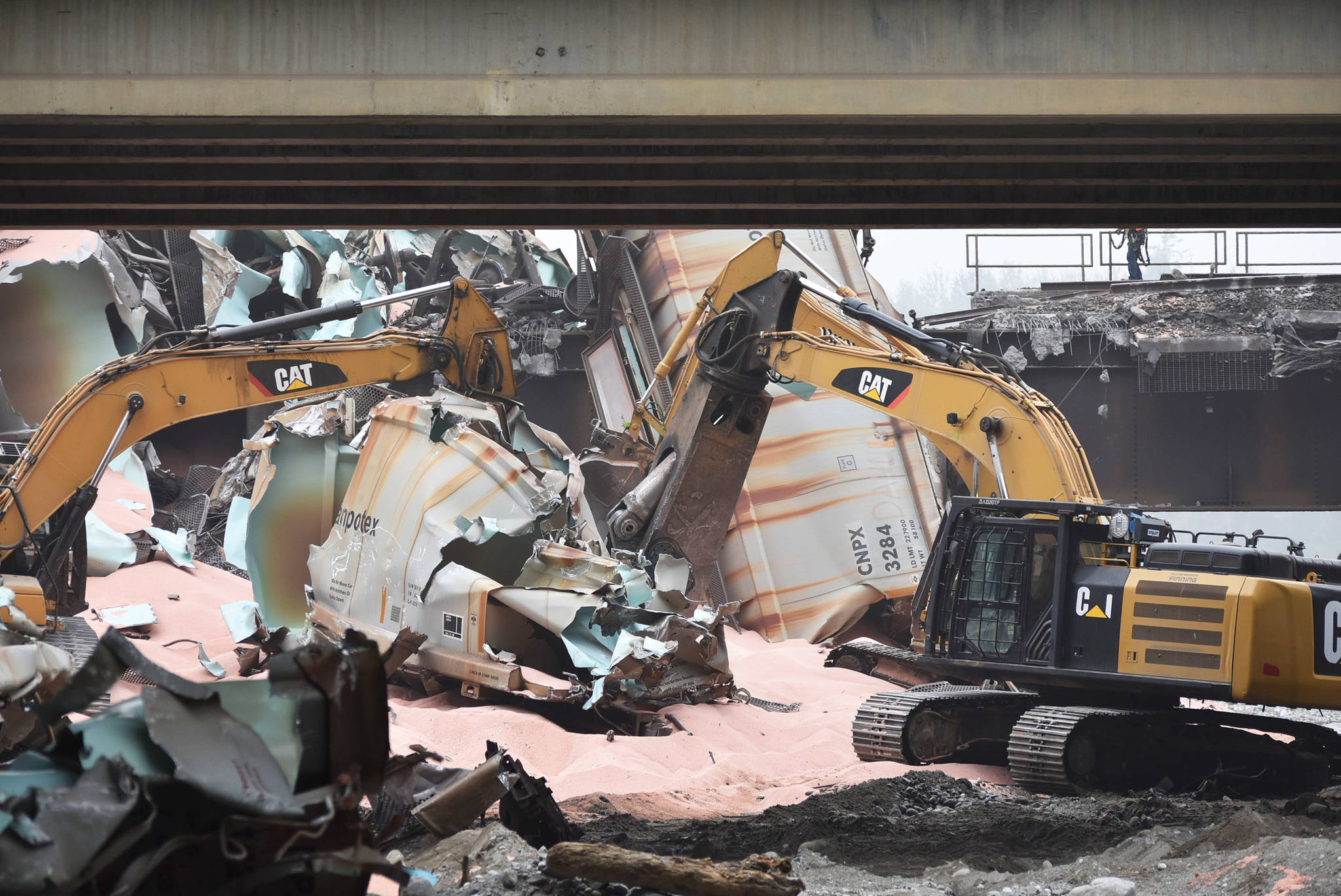 Heavy machinery was used to dismantle and moved the wreckage from approximately 60 rail cars involved in a crash Sept. 14. (Emelie Peacock/Hope Standard)
